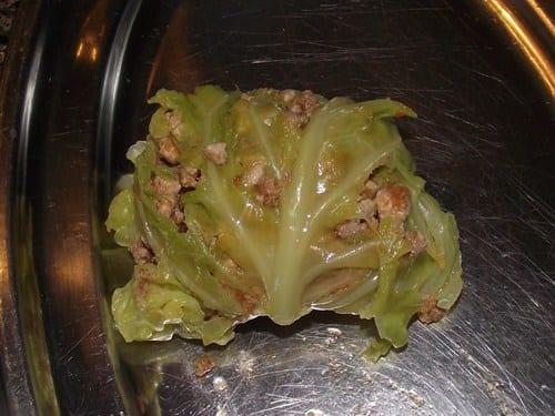 receta finalizada de saquitos de col rellenos