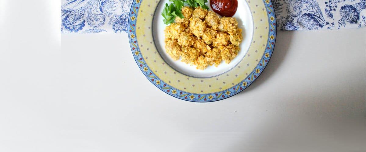 Nuggets de pollo rebozado con copos de maiz
